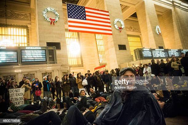 Demonstrators stage a DieIn in Grand Central Terminal protesting the Staten Island New York grand jury's decision not to indict a police officer...