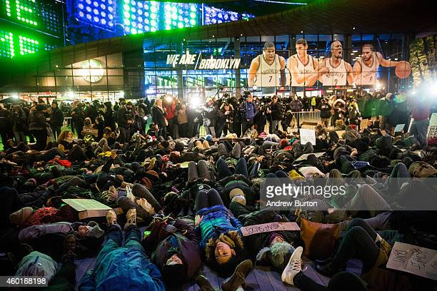 Demonstrators stage a diein outside the Barclays Center during a Brooklyn Nets game to protest a Staten Island New York grand jury's decision not to...