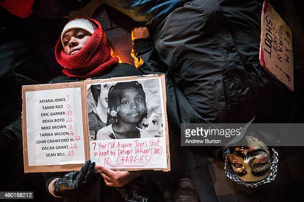 Demonstrators stage a diein outside the Barclays Center during a Brooklyn Nets game protesting the Staten Island New York grand jury's decision not...