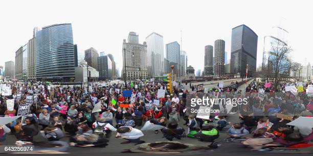 Demonstrators stage a Presidents Day protest near Trump Tower on February 20 2017 in Chicago Illinois The demonstration was one of many antiTrump...