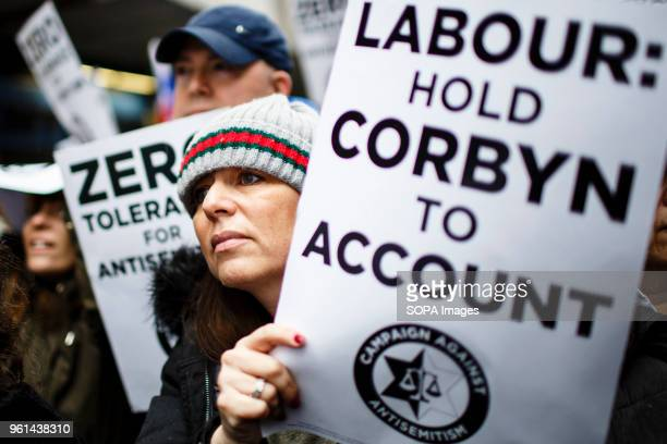 Demonstrators stage a protest against antiSemitism in Britain's Labour Party amidst ongoing criticism of the party and its leader Jeremy Corbyn for...