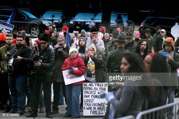 Demonstrators stage a protest at the entrance of the Greenbrier resort where US President Donald Trump addresses the 2018 House Senate Republican...