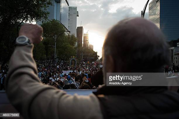 Demonstrators stage a protest to demand the appearance of the life of 43 missing students of Ayotzinapa in Mexico City Mexico on December 6 2014...