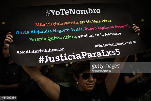 Demonstrators stage a protest to demand the clarification of the murder of photojournalist Ruben Espinosa who was killed in Mexico City along with...