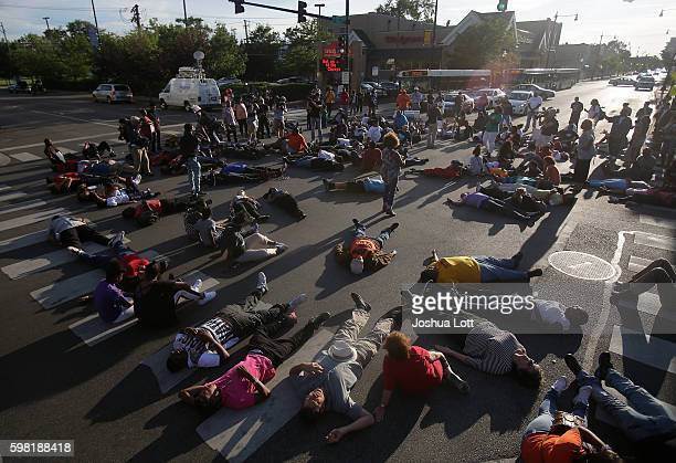 Demonstrators stage a sitin as they protest the recent uptick in homicides across the city on August 31 2016 in Chicago Illinois Chicago has seen...