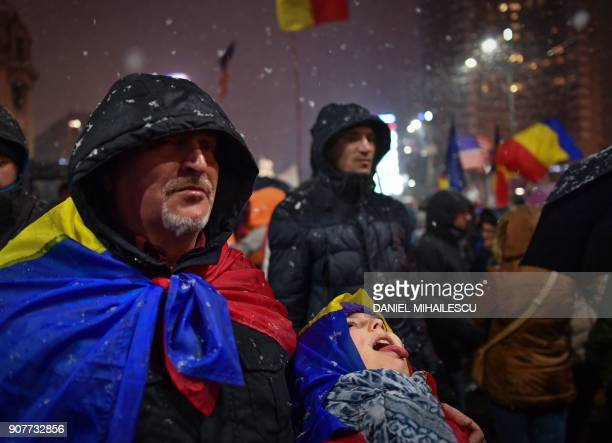 Demonstrators stage an antigovernment and anticorruption protest in Bucharest January 20 2018 More than 30000 people in Bucharest and in other cities...