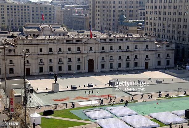 Demonstrators stand a protest in the fountain of La Moneda presidential palace in Santiago on September 16 2010 in support of the 35 Mapuche...