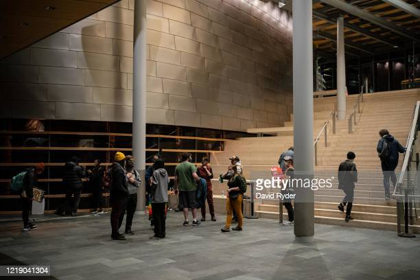 Demonstrators stand inside Seattle City Hall after marching inside with a group led by Seattle City Council member Kshama Sawant on June 9, 2020 in...