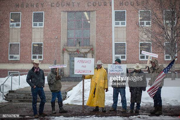 Demonstrators stand near a court house during a protest against government actions in Burns Oregon on January 29 a day after the FBI released video...