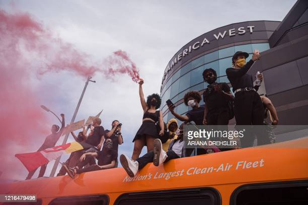 Demonstrators stand on a bus in the Fairfax district of Los Angeles on May 30, 2020 during a protest against the death of George Floyd, an unarmed...