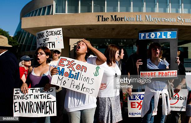 Demonstrators stand outside of the Exxon Mobil Corp annual shareholders meeting at the Morton H Meyerson Symphony Center in Dallas Texas US on...