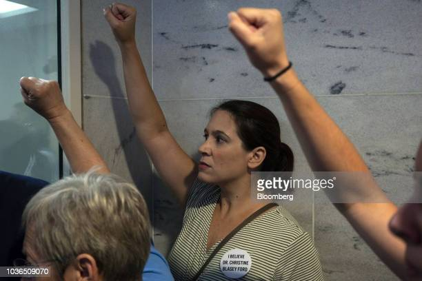 Demonstrators stand outside the office of Senator Chuck Grassley a Republican from Iowa and chairman of the Senate Judiciary Committee during a...