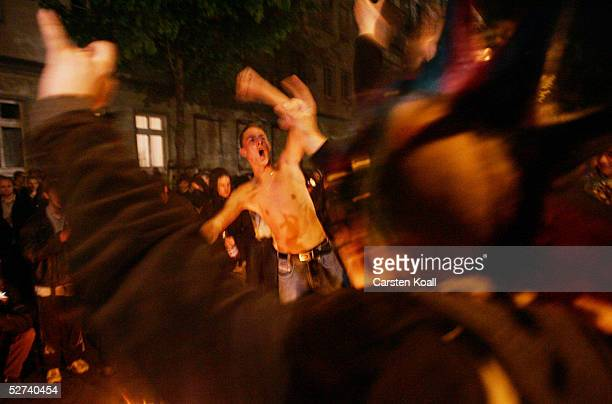 Demonstrators struggle with German riot police in the district of Friedrichshain April 30 2005 in Berlin Germany Walpurgis Night or Walpurgisnacht...