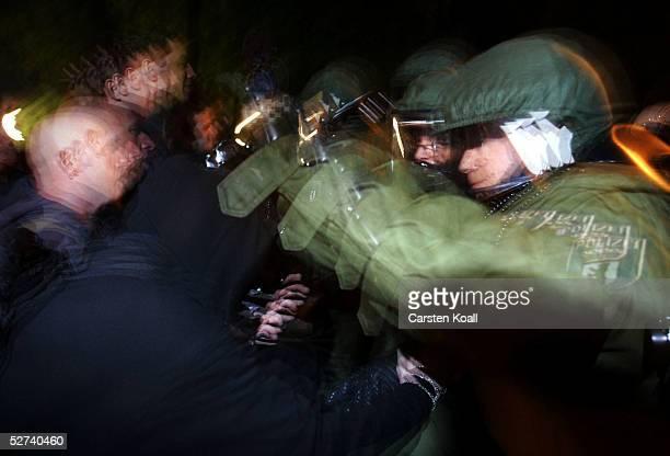 Demonstrators struggle with German riot police in the district of Friedrichshain April 30 2005 in Berlin Germany Walpurgis Night or Walpurgisnacht...