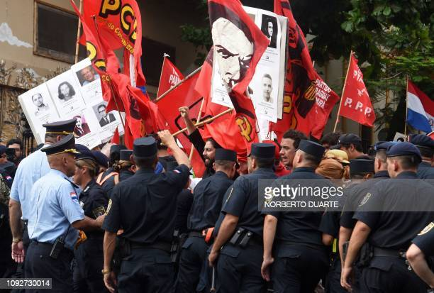 Demonstrators struggle with the police during the commemoration of the 30th anniversary of the end of the dictatorship of General Alfredo Stroessner...