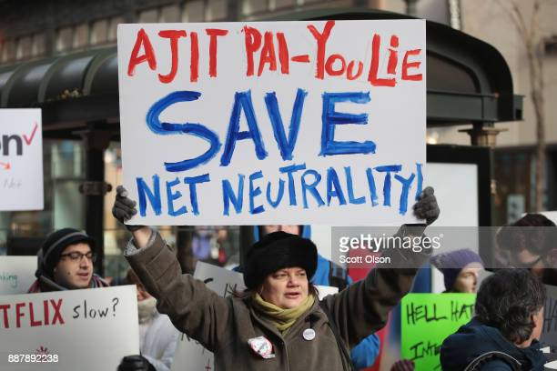 Demonstrators supporting net neutrality protest a plan by the Federal Communications Commission to repeal restrictions on internet service providers...