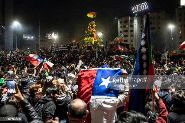 Demonstrators supporting the reform of the Chilean constitution celebrate while waiting for the referendum official results at Plaza Italia square in...