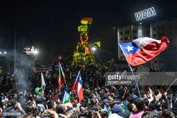 Demonstrators supporting the reform of the Chilean constitution celebrate the referendum official results at Plaza Italia square in Santiago on...