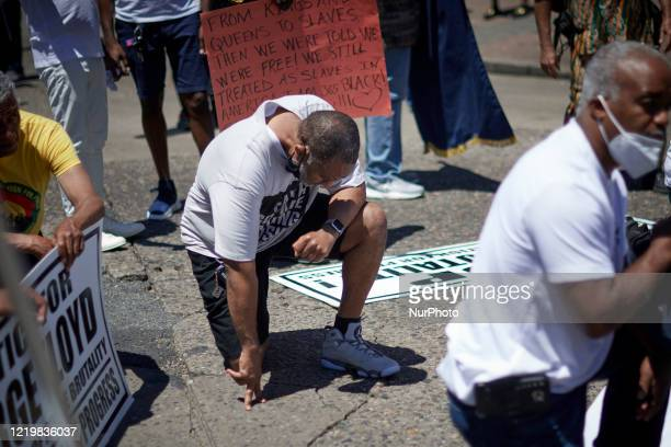 Demonstrators take a knee 8 minutes and 46 seconds during a Black Lives Matter protest march in Camden NJ on June 13 2020 Organized by Black Men...