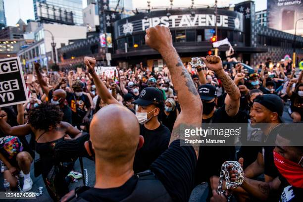 Demonstrators take a knee outside the Target Center and First Avenue during the Black 4th protest in downtown on July 4, 2020 in Minneapolis,...
