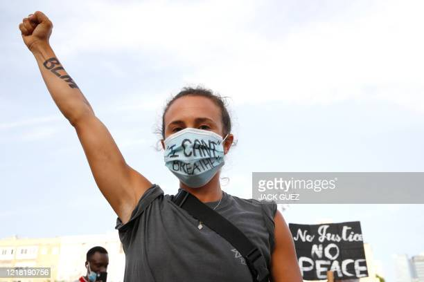 Demonstrators take part in a demonstration in support of US protesters over the death George Floyd an unarmed black man who died after a white...