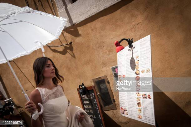 Demonstrators take part in a flash mob protest of brides in Trevi's fountain for the forced postponement of their marriages due to the coronavirus...