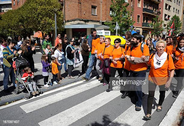 Demonstrators take part in a march against the arrest of eight members of the Basque proindependence youth organization SEGI in the northern Spanish...