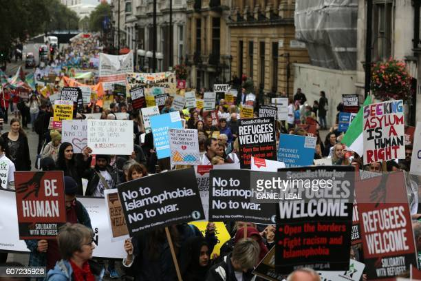 Demonstrators take part in a march calling for the British parliament to welcome refugees in the UK in central London on September 17 2016 Thousands...