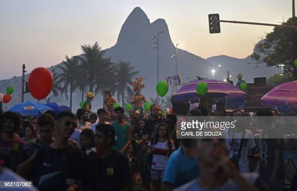 Demonstrators take part in a march calling for the legalization of cannabis in Rio de Janeiro Brazil on May 5 2018 Following Uruguay's decision to...
