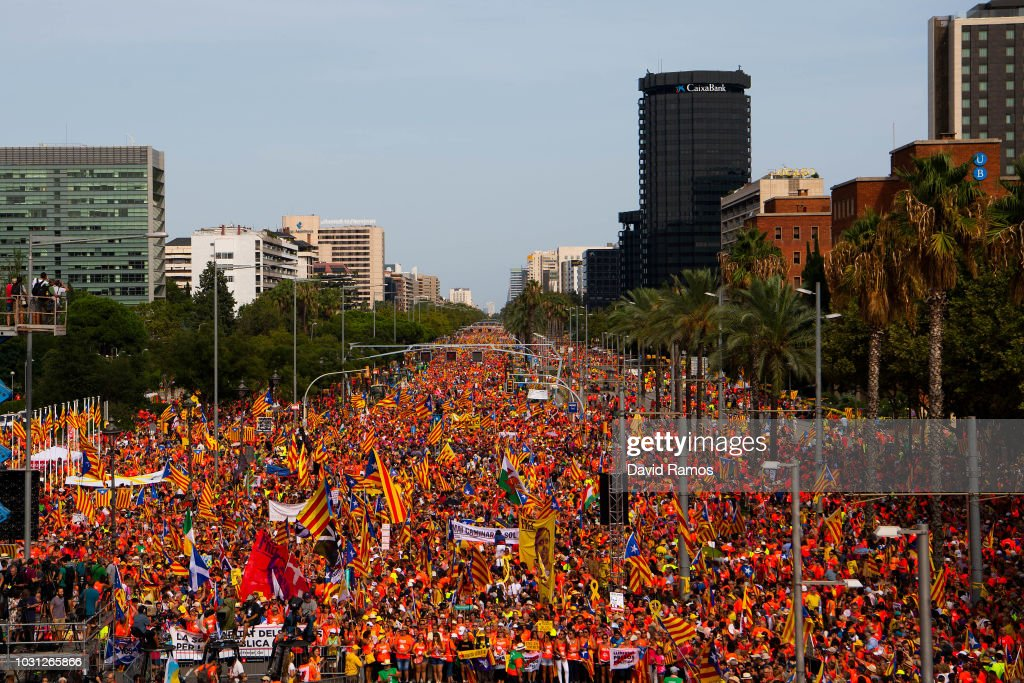Demonstrators take part in a march celebrating the Catalan National day on September 11, 2018 in Barcelona, Spain. The Spanish northeastern autonomous region celebrates its National Day on September 11, ahead of the 1st anniversary of the secession referendum held last October 1, which was approved by the Catalan Government and banned by the Spanish government. The Catalan National Day, also known as 'Diada', remembers the fall of Barcelona during the Spanish Succession's War in 1714 and the subsequent abolishment of its institutions and freedoms.