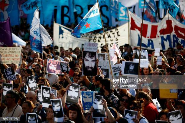 Demonstrators take part in a march to demand justice for late activist Santiago Maldonado at Plaza de Mayo square in Buenos Aires on November 1 three...