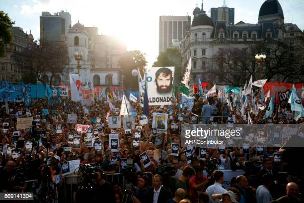 TOPSHOT Demonstrators take part in a march to demand justice for late activist Santiago Maldonado at Plaza de Mayo square in Buenos Aires on November...