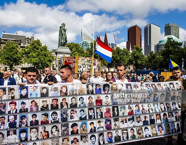 OUT*** Demonstrators take part in a peace march in remembrance of the victims of the 1995 Srebrenica massacre in The Hague on July 11 2016 127 newly...