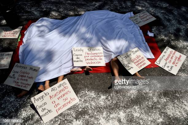 TOPSHOT Demonstrators take part in a performance during a march on the International Day for the Elimination of Violence against Women in Cali Valle...