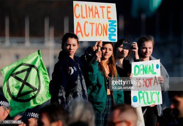 Demonstrators take part in a proenvironment protest as they block Westminster Bridge in central London on November 17 to show anger at what they see...