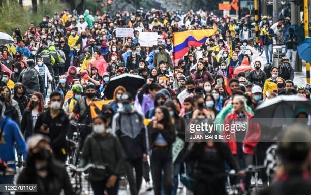 Demonstrators take part in a protest against a tax reform proposed by Colombian President Ivan Duque's government in Bogota, on May 4, 2021. - The...
