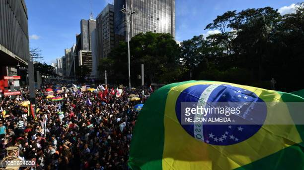 Demonstrators take part in a protest against Brazilian rightwing presidential candidate Jair Bolsonaro in Sao Paulo Brazil on October 20 2018