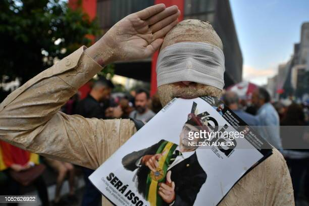 TOPSHOT Demonstrators take part in a protest against Brazilian rightwing presidential candidate Jair Bolsonaro in Sao Paulo Brazil on October 20 2018