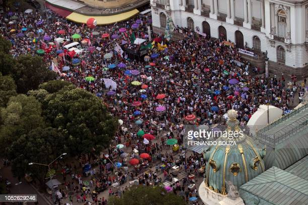 Demonstrators take part in a protest against Brazilian rightwing presidential candidate Jair Bolsonaro called by a social media campaign under the...