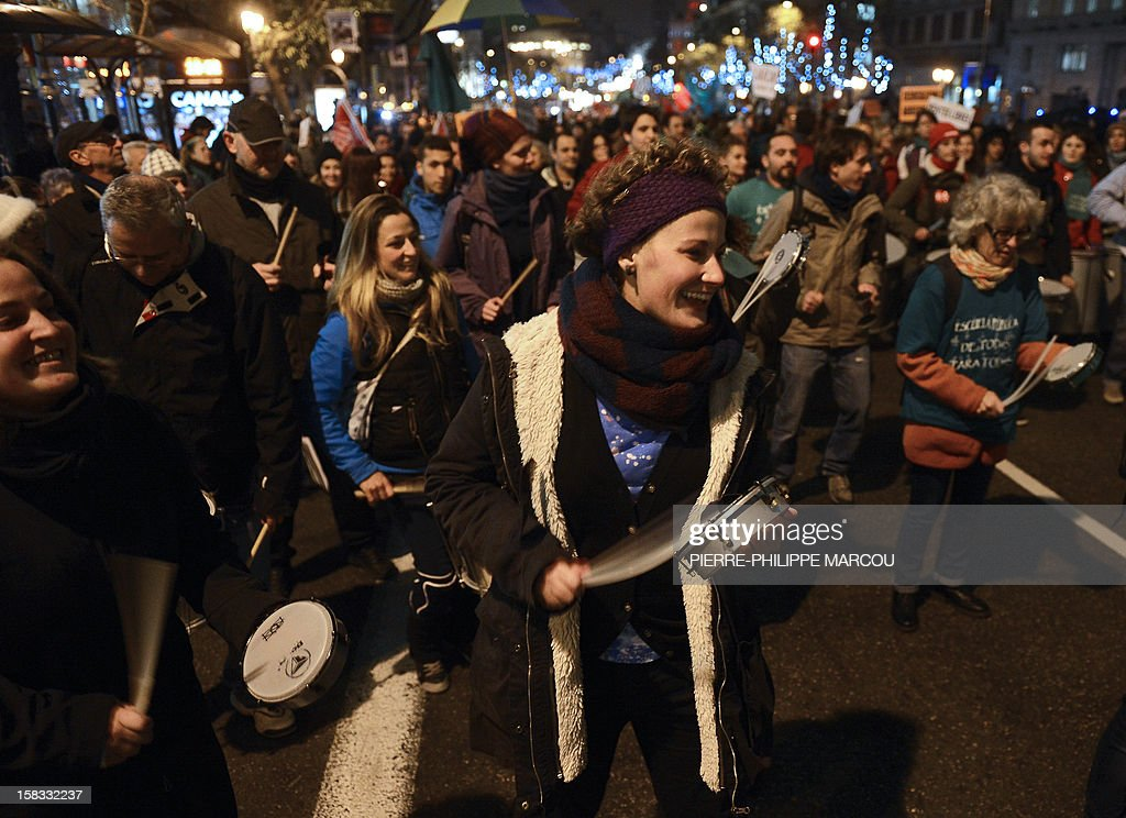 Demonstrators take part in a protest against government's austerity reforms and cuts in Madrid on December 13, 2012. Public spending on education has been cut by more than a billion euros this year compared with 2011, and public schools employed nearly 3,000 fewer teachers during the 2011-12 academic year, according to the education ministry.