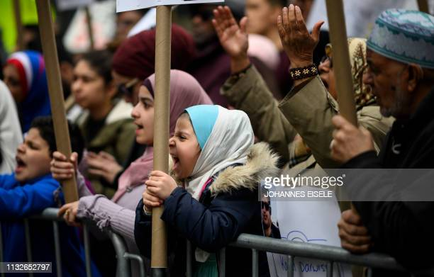 Demonstrators take part in a protest against growing Islamophobia white supremacy and antiimmigrant bigotry following the attacks at Christchurch New...