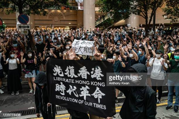 Demonstrators take part in a protest against the new national security law on July 1, 2020 in Hong Kong, China. Hong Kong marks the 23rd anniversary...
