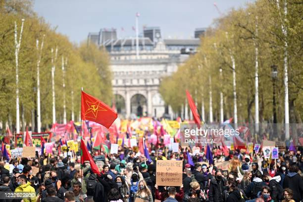 Demonstrators take part in a protest against the Police, Crime, Sentencing and Courts Bill 2021 along The Mall in central London on May 1, 2021. -...