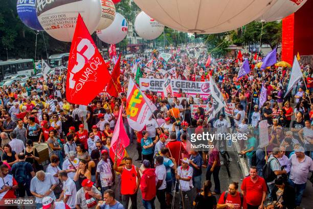 Demonstrators take part in a protest against the social welfare reform bill introduced by President Michel Temer government which seeks to extend the...