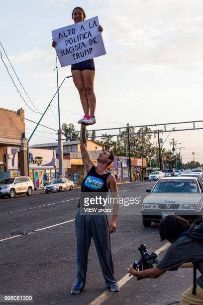 Demonstrators take part in a protest against US president Donald Trump migration policies in the border between Mexico and the US on July 10 2018 in...