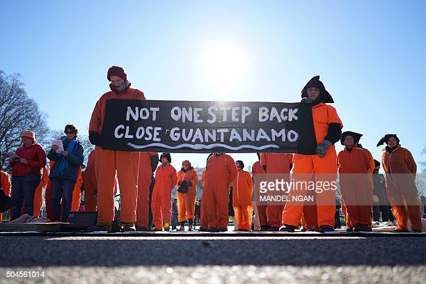Demonstrators take part in a protest calling for the closure of the Guantanamo Bay US prison on January 11 2016 in front of the White House in...