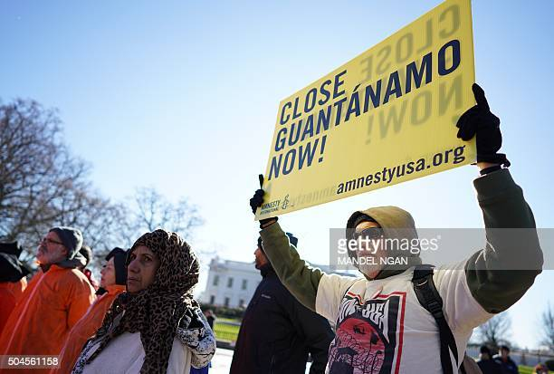Demonstrators take part in a protest calling for the closure of the Guantanamo Bay prison on January 11 2016 in front of the White House in...