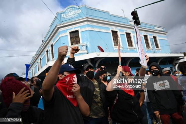 Demonstrators take part in a protest demanding the resignation of Guatemalan President Alejandro Giammattei, in Guatemala City on November 22, 2020....