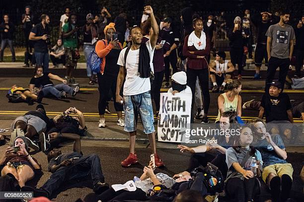 Demonstrators take part in a protest on September 22 2016 in Charlotte NC Protests began on Tuesday night following the fatal shooting of 43yearold...