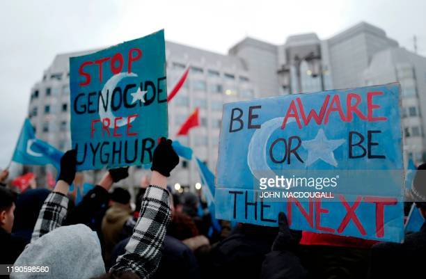 Demonstrators take part in a protest outside the Chinese embassy in Berlin on December 27 to call attention to Chinas mistreatment of members of the...